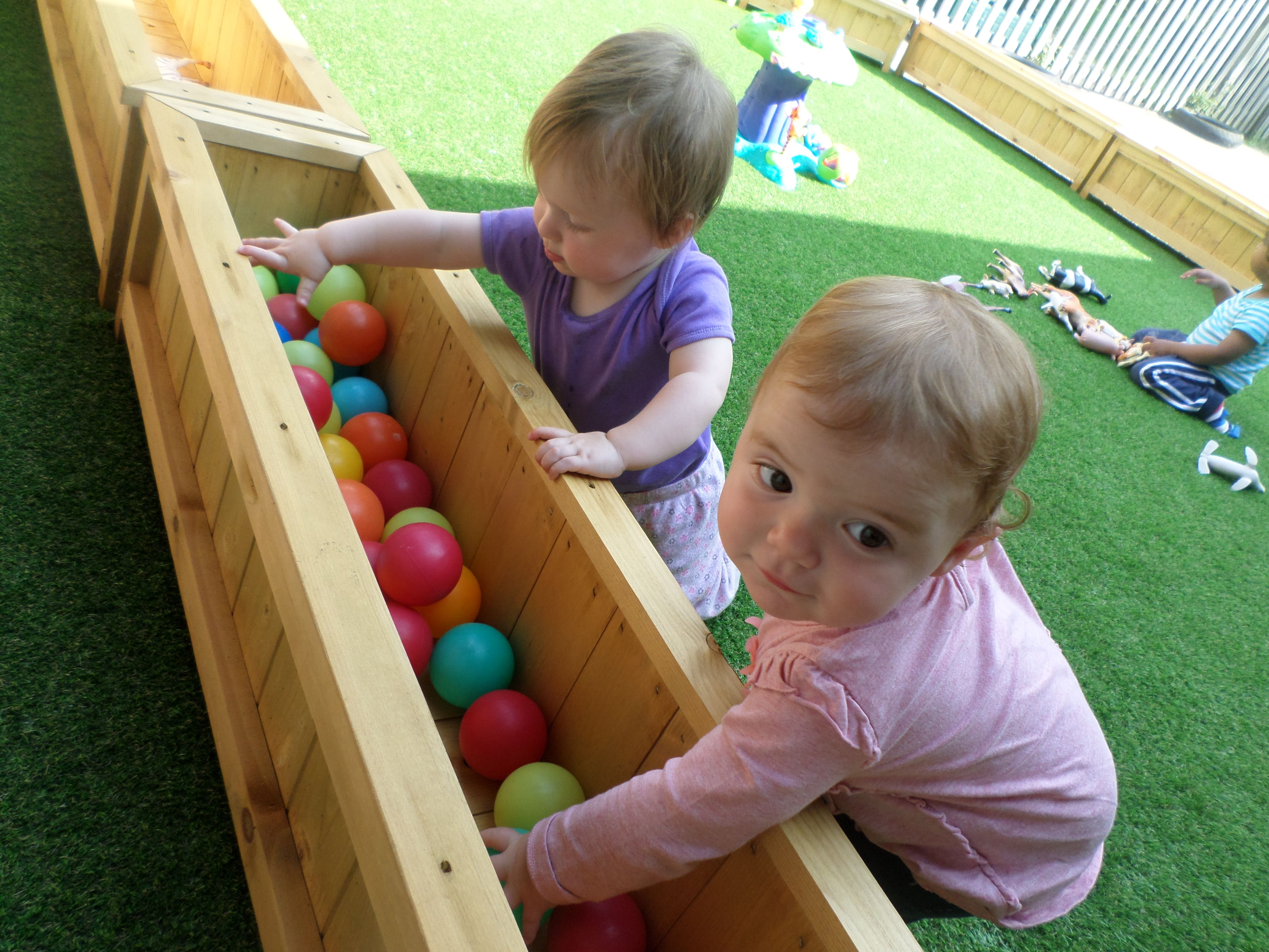 soft astro turf and low level games make the babies area a