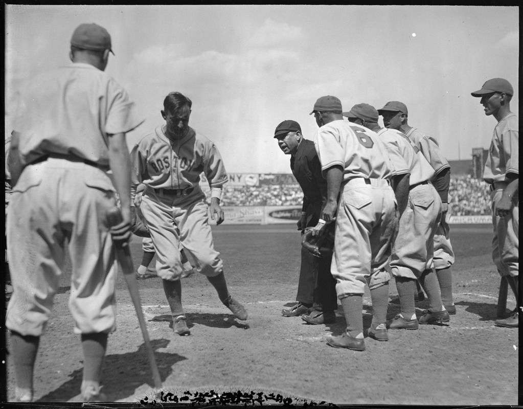 Boston Bees manager Bill McKechnie leads a group of his