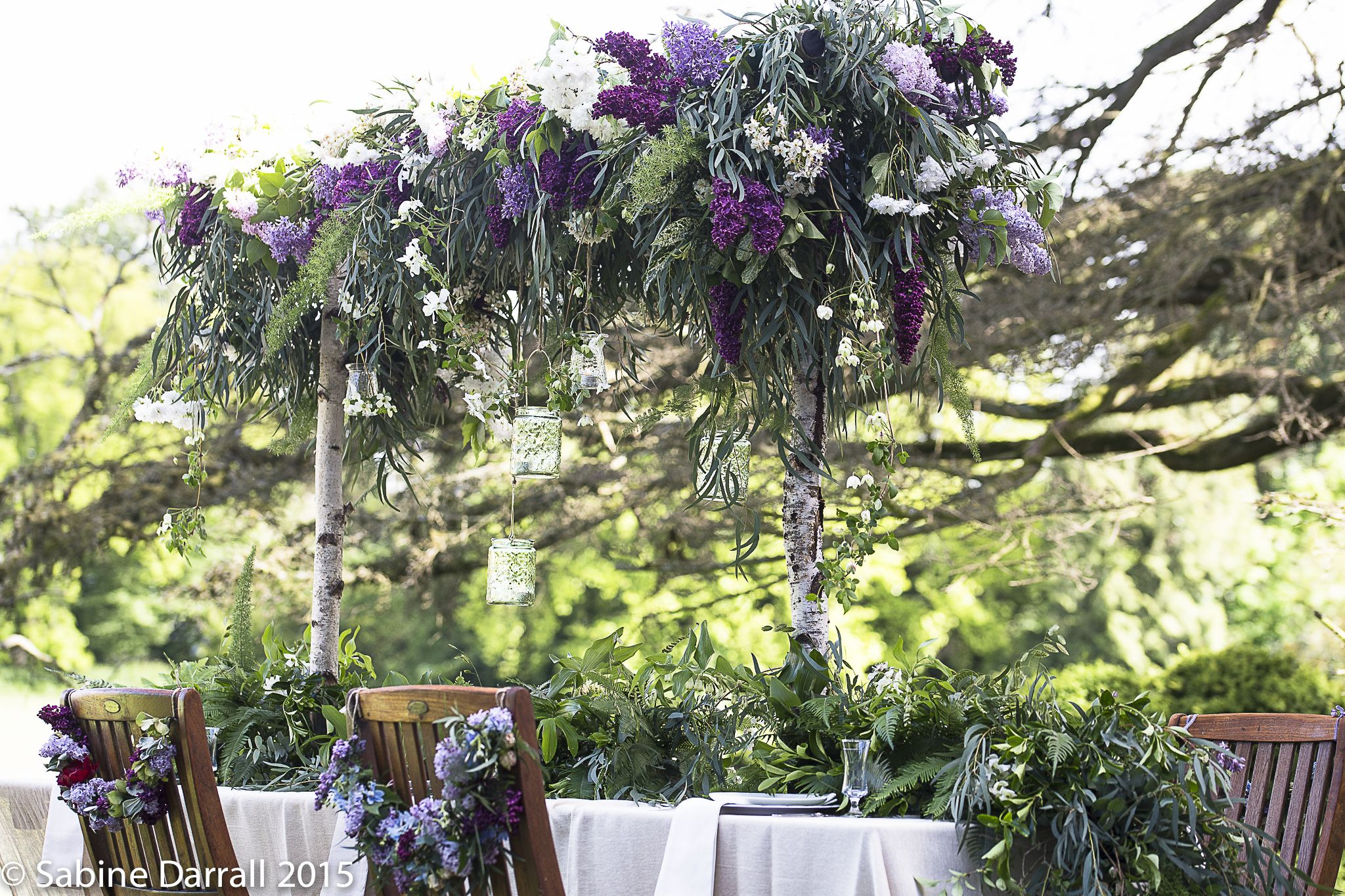 Hanging table canopy created by our students  on the first day Rustic wedding