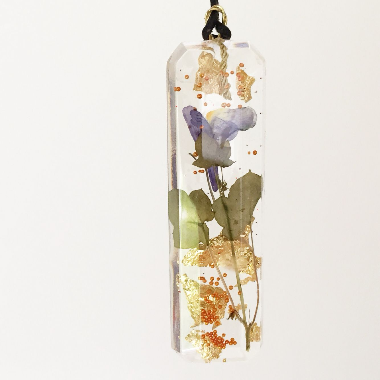 My own work. Resin pendant with dried flowers, gold flakes