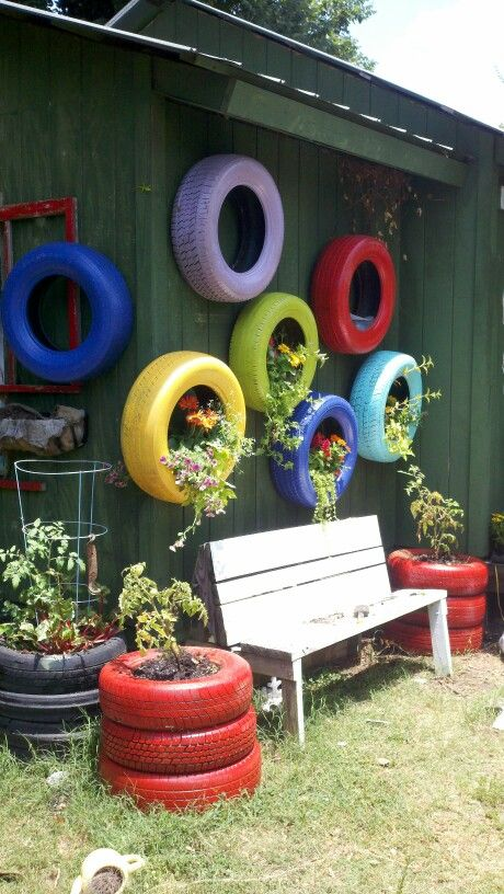 Painted tires into flower pots.