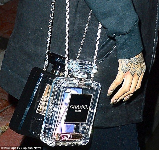 916d0c142f8d Rihanna brings her own bottles to lunch in the form of Chanel ...