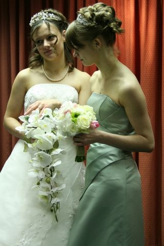 My sister and I on my wedding day with our bouquets.