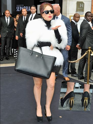Lady Gaga 'Fame' Eau De Parfum Launch, Paris- Lady Gaga looks like a ball of fluff, and her hair colour is super strange. But perhaps the oddest part is her shoes (you can see them in the inset) - what's with those heels!