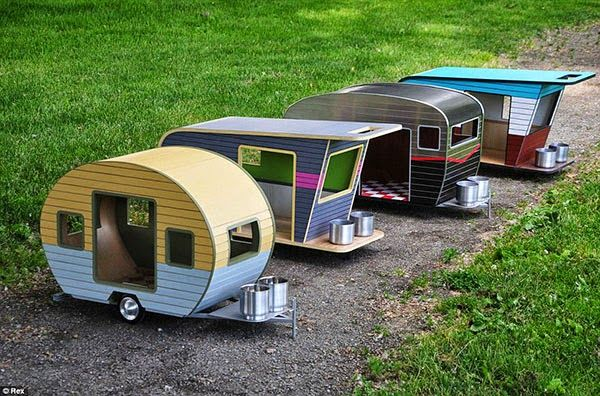 A Custom Made Dog House Shaped Like A Camper Which Comes In Four