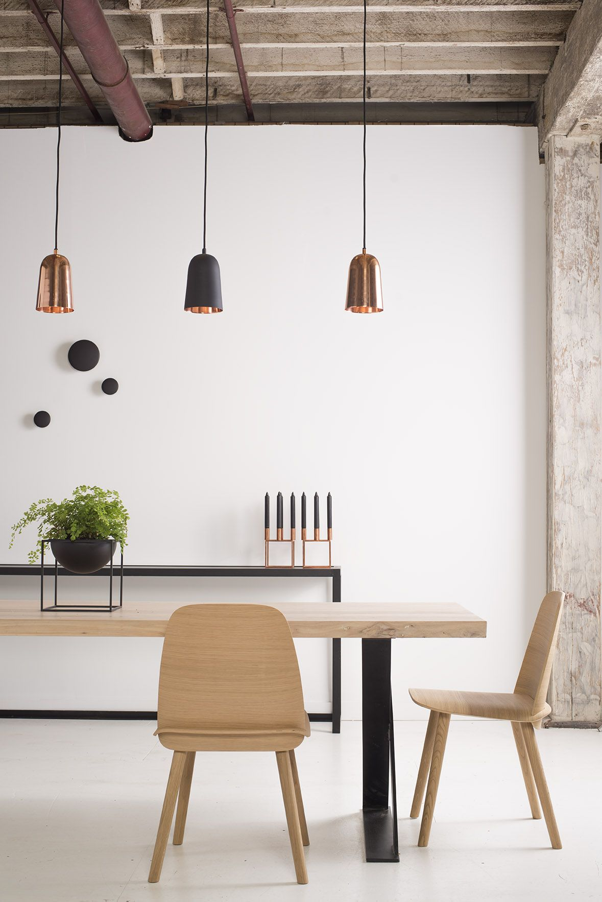 Showroom shot. Hudson Dining Table and Muuto Nerd Oak Dining Chairs. Muuto Black Dots on the Wall as well as By Lassen Kubus Candleholders and Kubus Bowls. All available in our online boutique!
