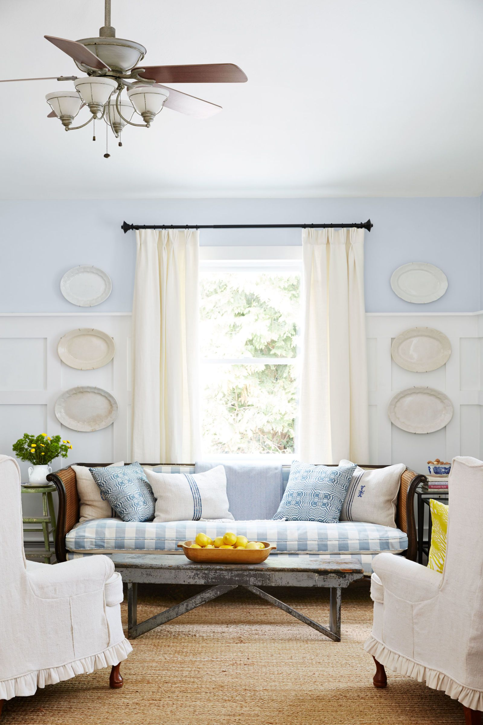 The Centerpiece Of The Family Room Is A Cane Back Sofa With Blue  Buffalo Check Upholstery.