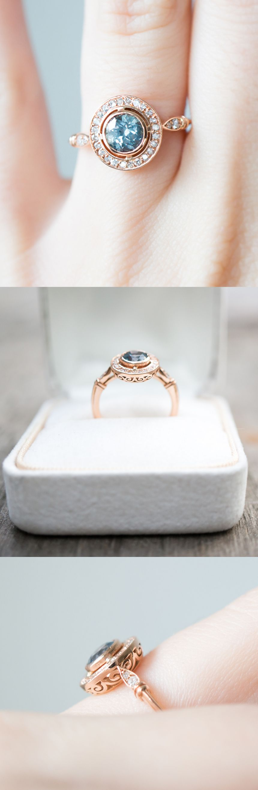 A detailed Halo engagement ring with a light blue sapphire and 28