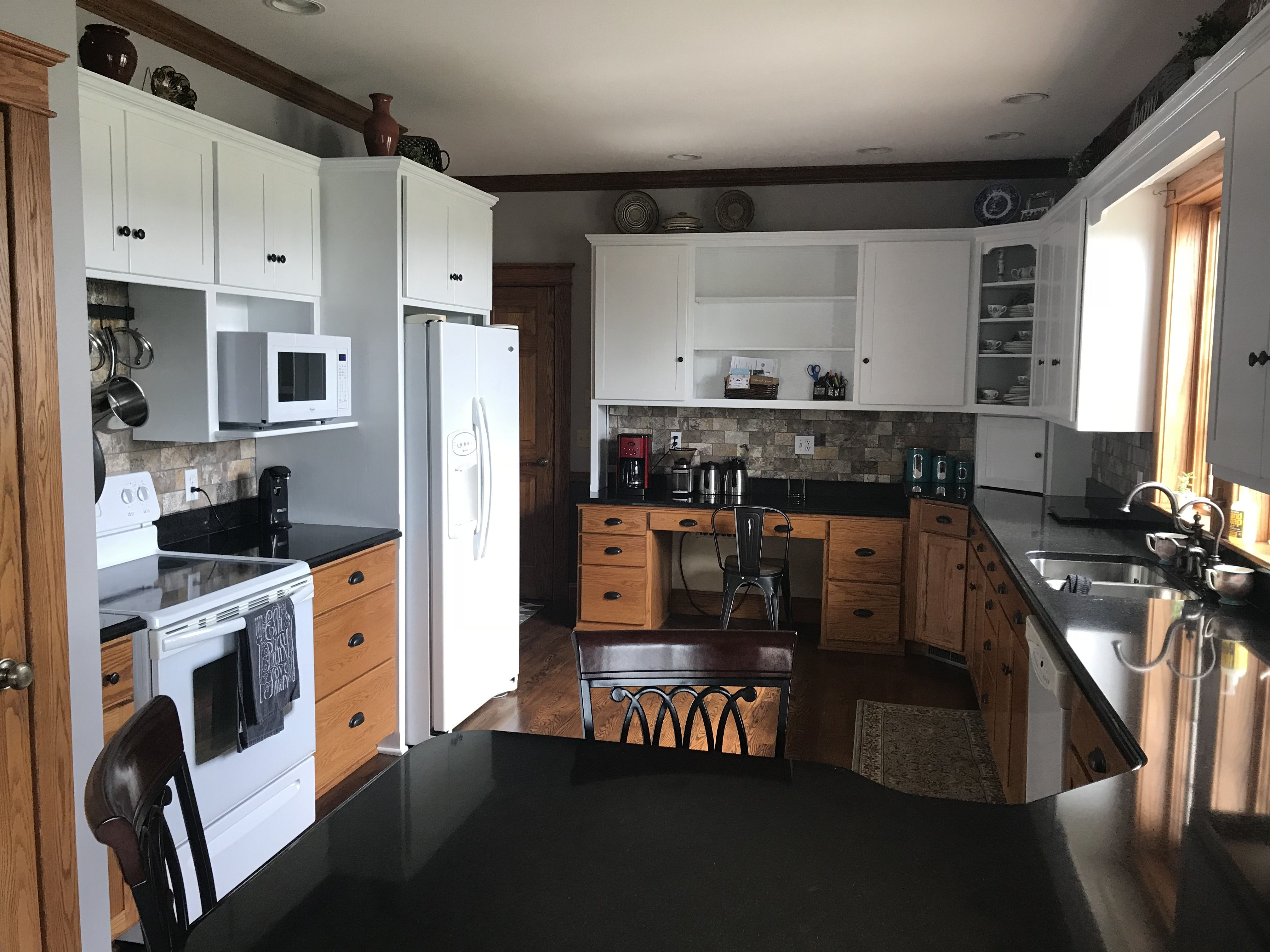 Loving my two toned kitchen! Newly painted white upper red