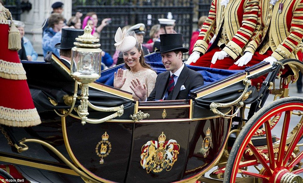 Diamond Jubilee.  The Duke and Duchess of Cambridge wave as they travel along Whitehall, through Admiralty Arch and along The Mall was lined by more than 1,000 servicemen and women from the three services