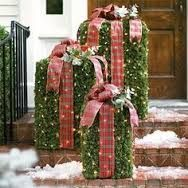 Decorative gifts out of chicken wire and evergreen bows.