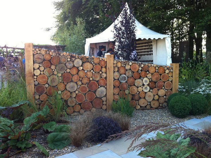 quirky garden divider idea to create areas - homefal.us | Logs ...