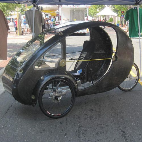 Is This Solar Powered Half Electric Bicycle With A Roof The Future Of Transportation Electric Bicycle Pedal Cars Solar Car