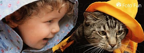 little girl and cat with raincoats