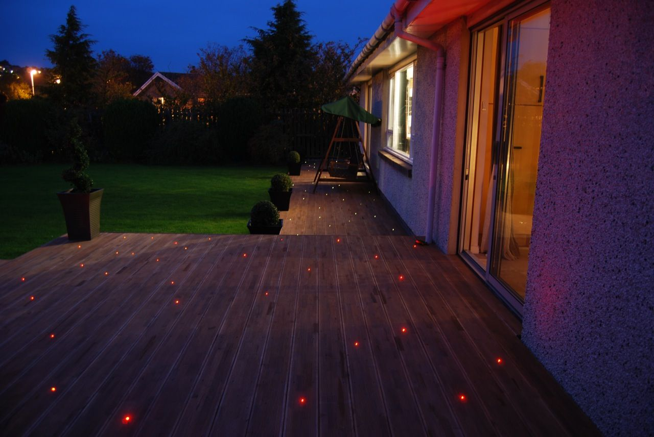 Lighting tricks designers use for awesome curb appeal deck patios enhance the look of your home while playing it safe with proper outdoor lighting workwithnaturefo