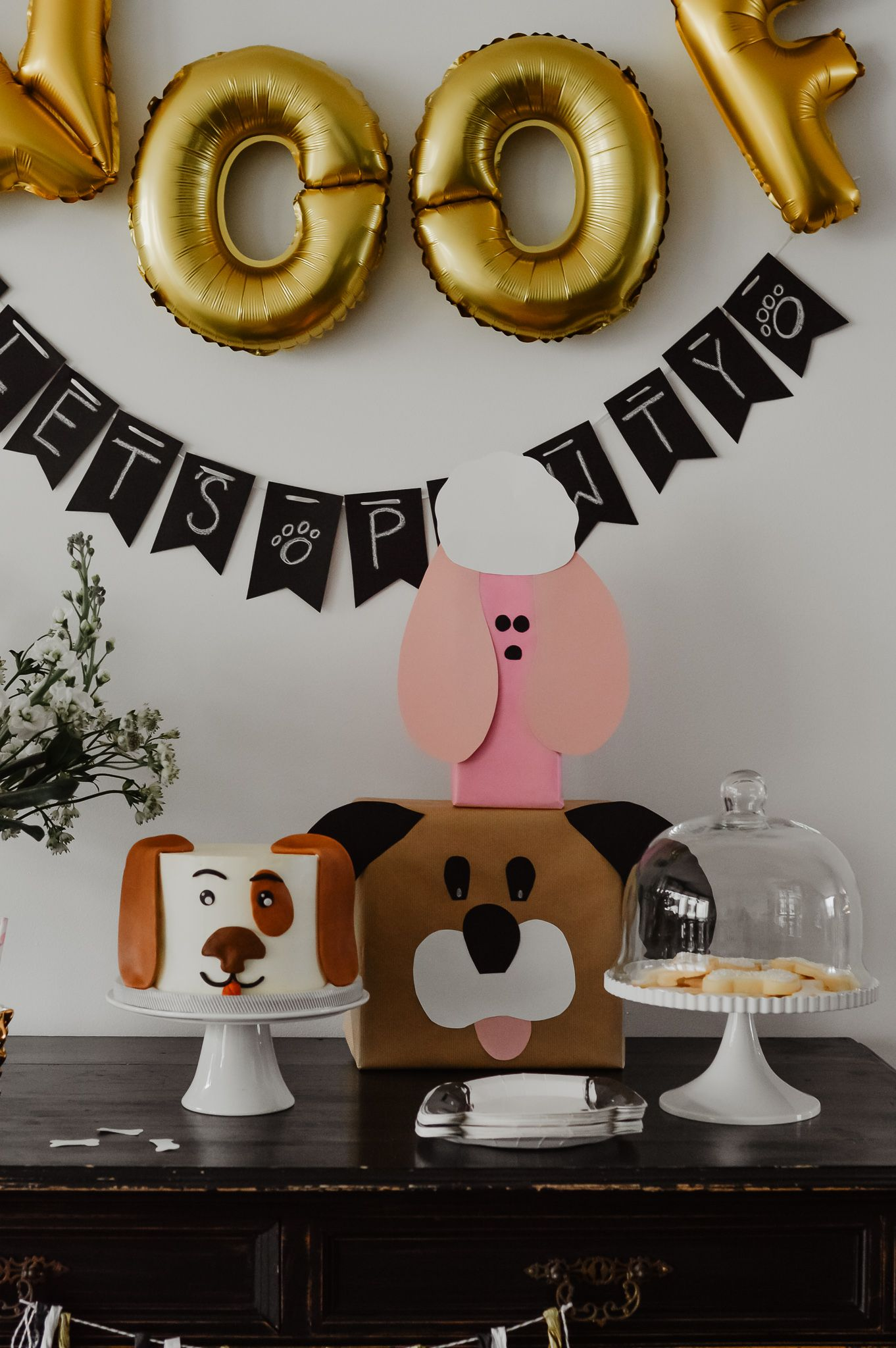 Woof The Ultimate Diy Puppy Pawty For Your Toddler With Dog Themed Cake Tips And Inspirat Dog Themed Birthday Party Dog Birthday Party Puppy Birthday Parties