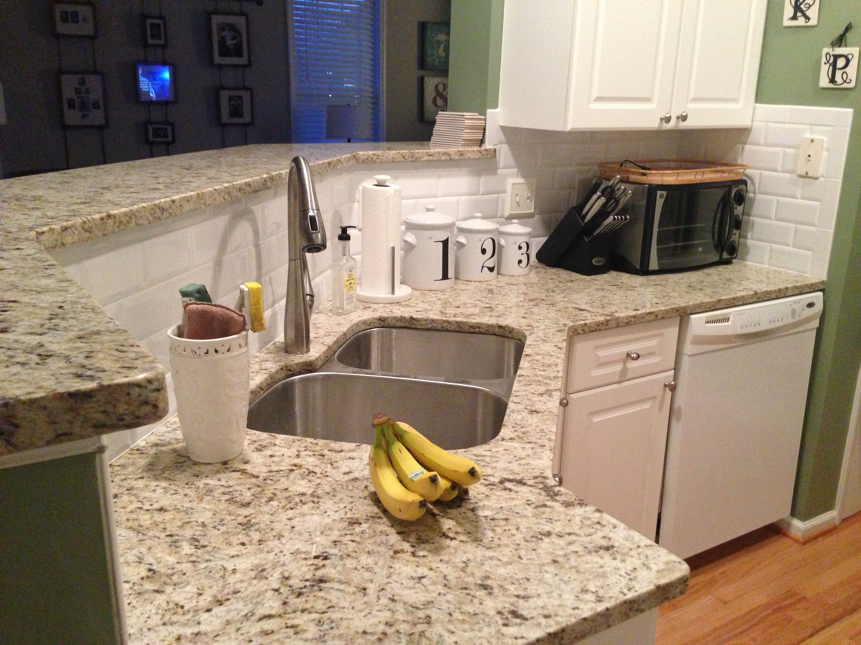 new giallo ornamental granite countertops and beveled subway tile backsplash