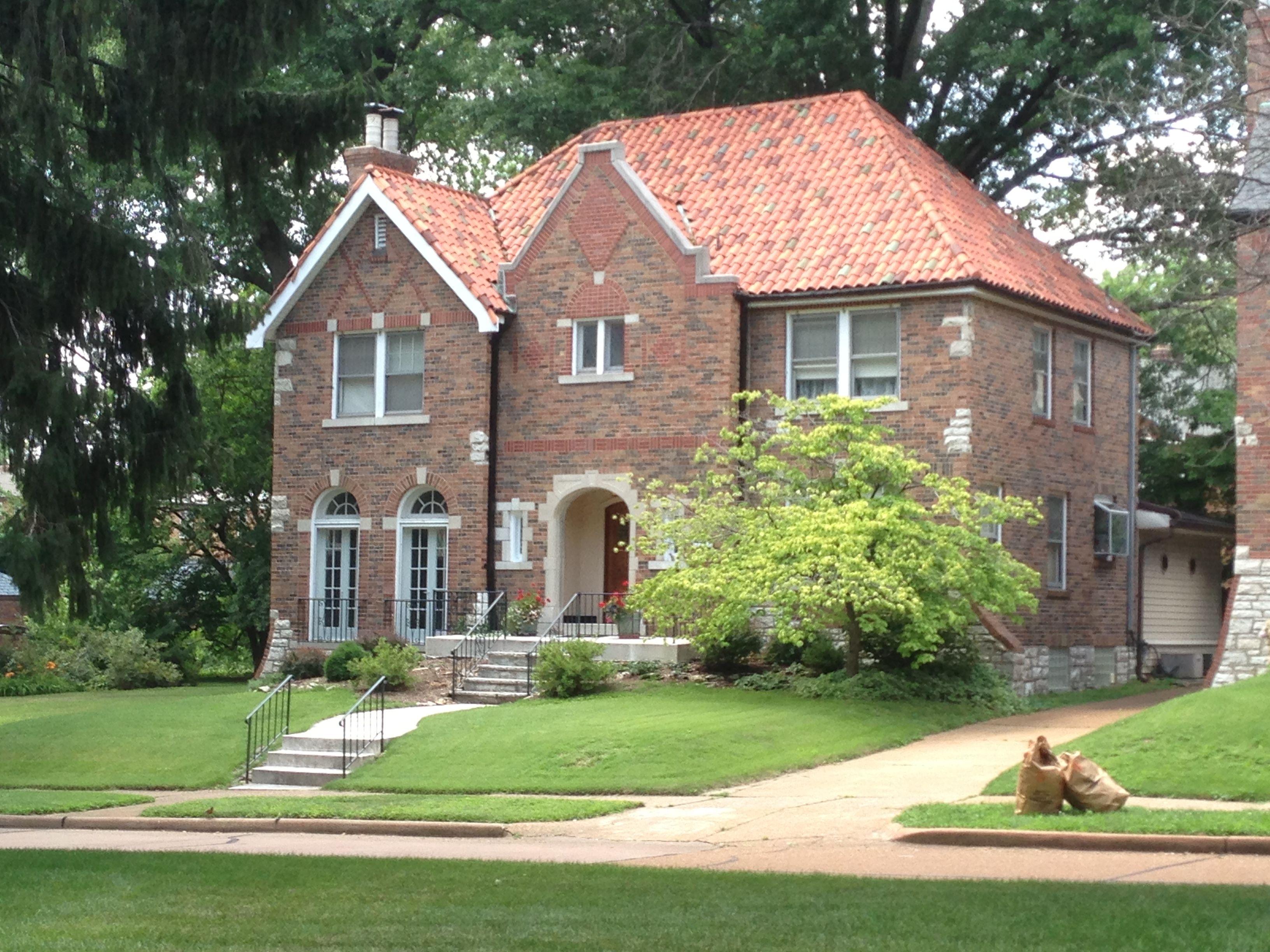 Pasadena Hills Mo. Brick Tudor Eclectic With Terra Cotta