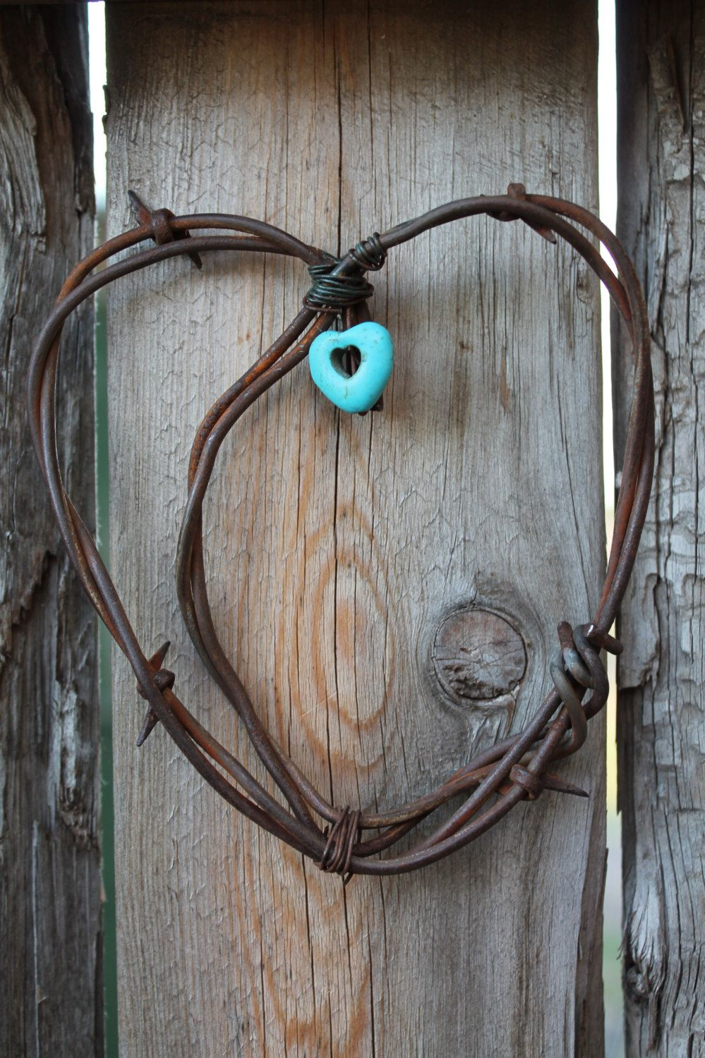 Handmade rusted barbed wire heart wall decor with turquoise heart ...