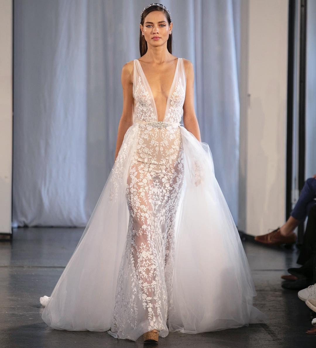"""efefc0c1 Front row at Berta Bridal Fall 2019 Collection runway featuring style  """"19-109"""" illusion deep V-neckline tulle sheath gown with delicate floral  embroidery ..."""
