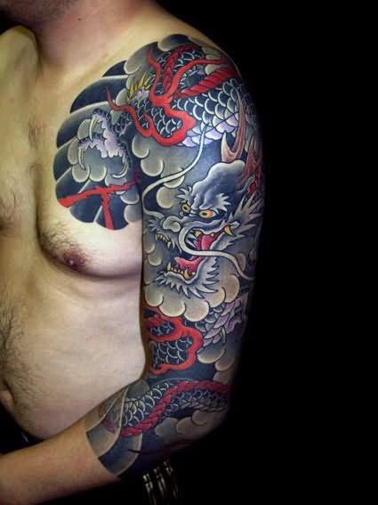 Black Ink Japanese Clouds With Dragon Tattoo On Man Left Half Sleeve