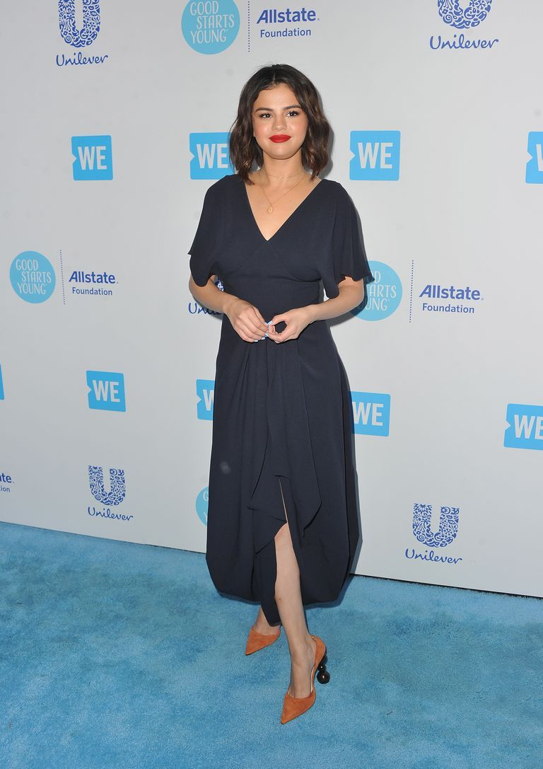 c9d49a1c999 Selena Gomez wearing Jacquemus Fall 2018 Souela Curved Hem Dress at We Day  California event.
