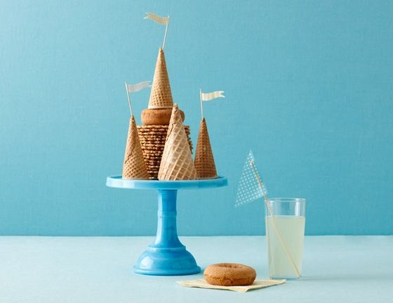 So simple I can't believe I didn't think of this! Make a castle cake out of ice cream cones and doughnuts.