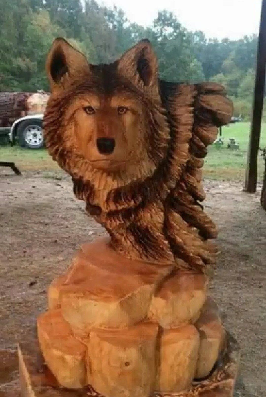 One word for this wooden wolf carving? ) Chainsaw wood