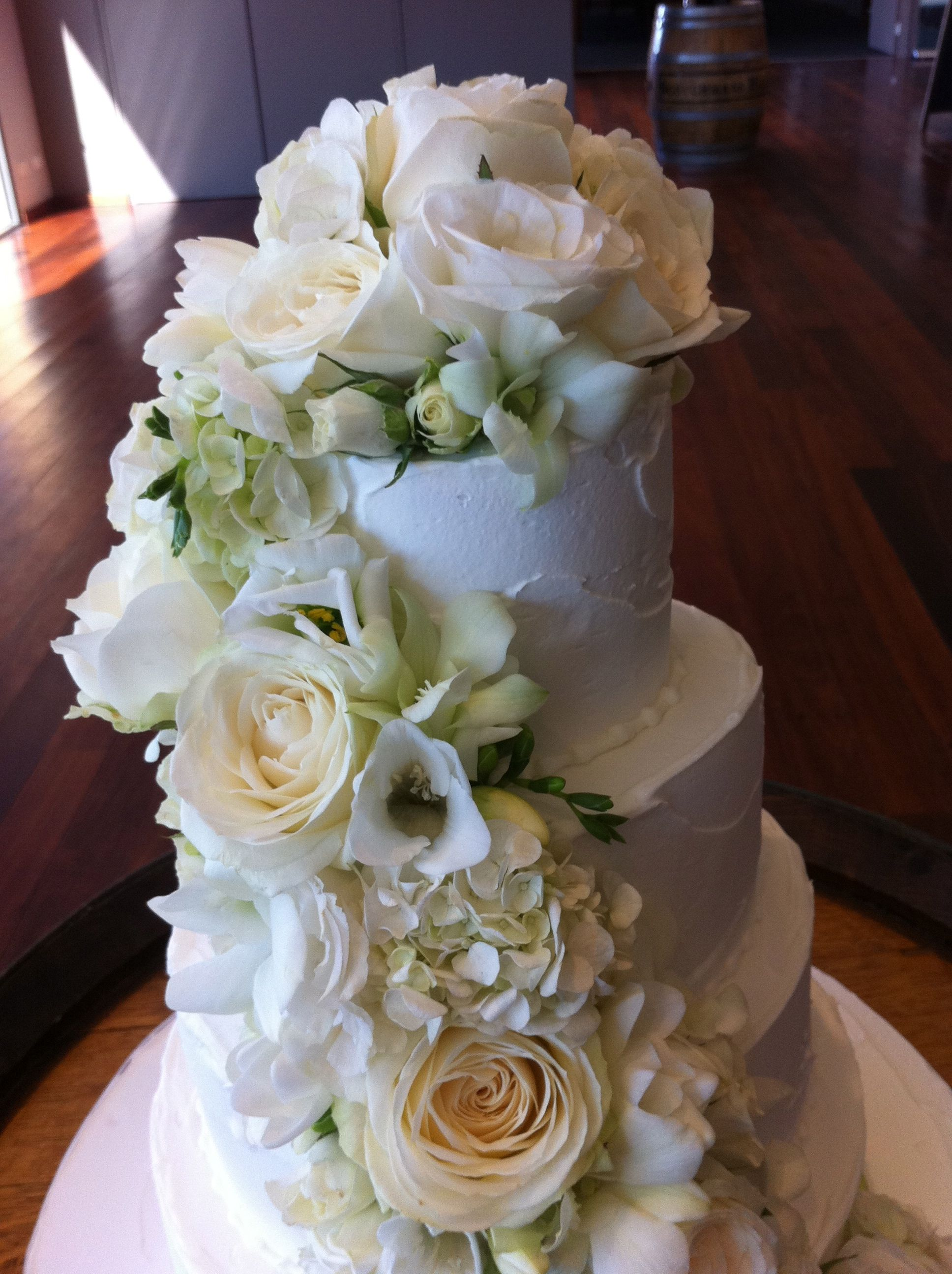 Cascading flowers sweet designs by claire wedding cake love