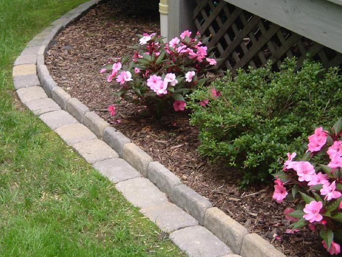 Cool Flower Bed Paver Edging, All You Need To Do Is Mow!   Edging A Flower  Bed With Cement Pavers   InfoBarrel