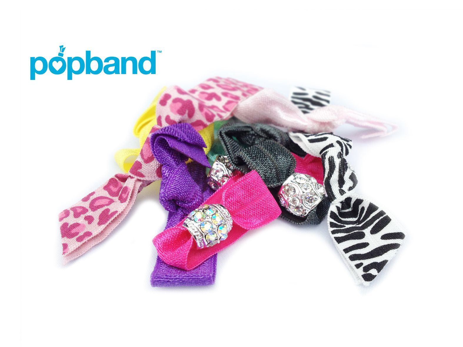 Pop Band - a hairband that leaves your hair flowing and kink-free, but out of your face. In a range of lovely summer colours, these are great for when the sun comes out (and finally stays out).