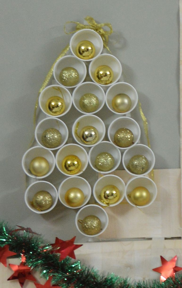 Simple And Easy Diy Just Pasted Paper Cups On Wall And Inserted Decoration Ball In It And Took And Ribbon Around And Tied On T Xmas Diy Easy Diy Christmas Diy