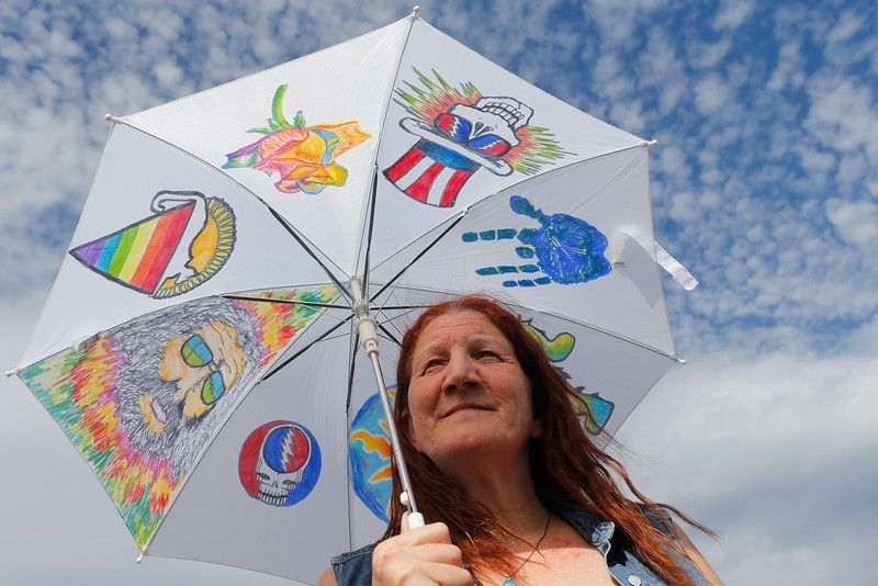 Michelle Doppelt, of San Leandro, decorated a sun umbrella and put it to use before the Grateful Dead concert at Levi's Stadium in Santa Clara, Calif., on Saturday, June 27, 2015. (Jim Gensheimer/Bay Area News Group)