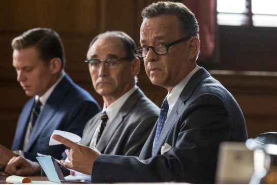 In Bridge of Spies, Tom Hanks, right, and Mark Rylance, centre, deliver golden performances as natural combatants who find common cause in seeking honest justice, even if only they realize it.