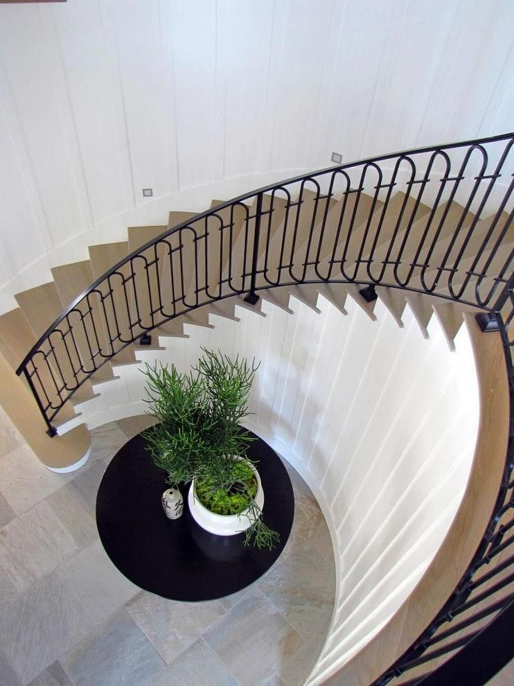 Fascinating Wrought Iron Railings For Stairs With Wooden Stair Then Plant  Above Round Table Under Stair