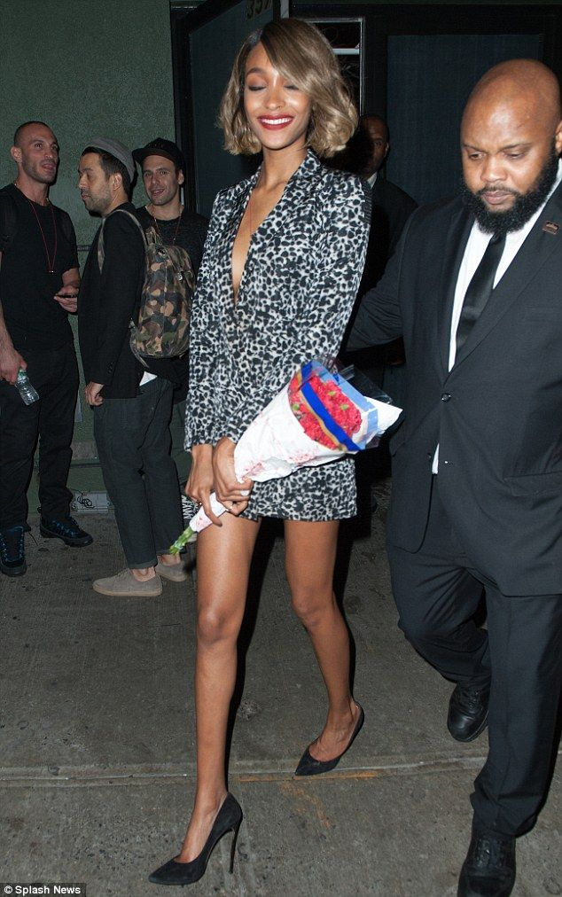 Jourdan Dunn  All smiles: The model's bright red lipstick really complemented her look
