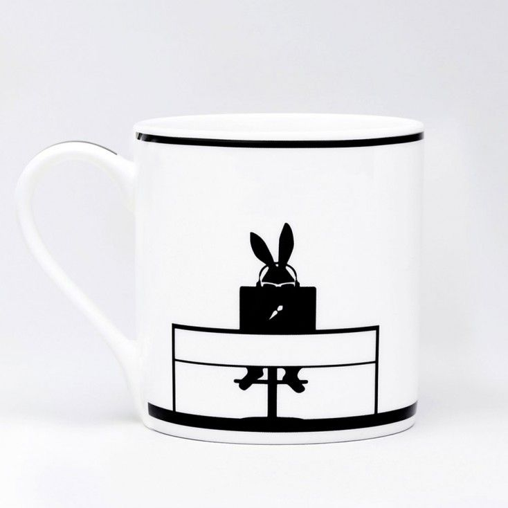 PERFECT EASTER OR RABBIT LOVER GIFT! HAM follows the contented life of Rabbit - capturing his daily adventures, sporting escapades and social outings in silhouette form.    Meet Working Rabbit - on one side he sits diligently working away, on the other he's listening to music - Echo & The Bunnymen maybe?   We can't think of a better way to start the day than having a brew in this witty fine china mug. Have you spotted the clever logo!