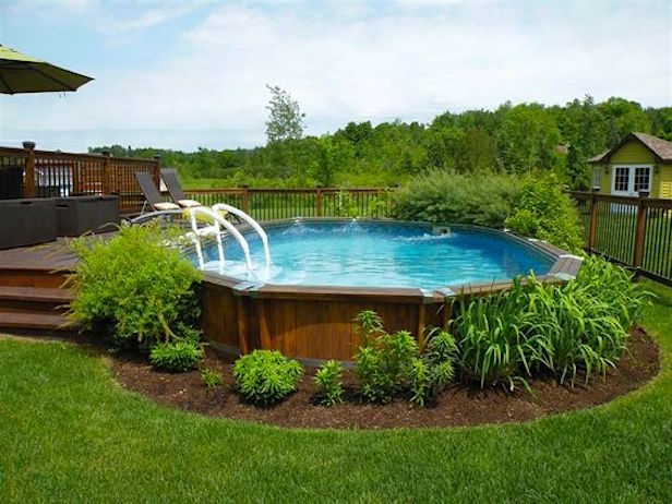 17 Ways to PrettyUp an AboveGround Pool is part of Above ground pool landscaping, Backyard pool designs, Backyard pool, Pool landscaping, Best above ground pool, Above ground pool decks - Give your splash pad a stylish spruce — just in time for summer