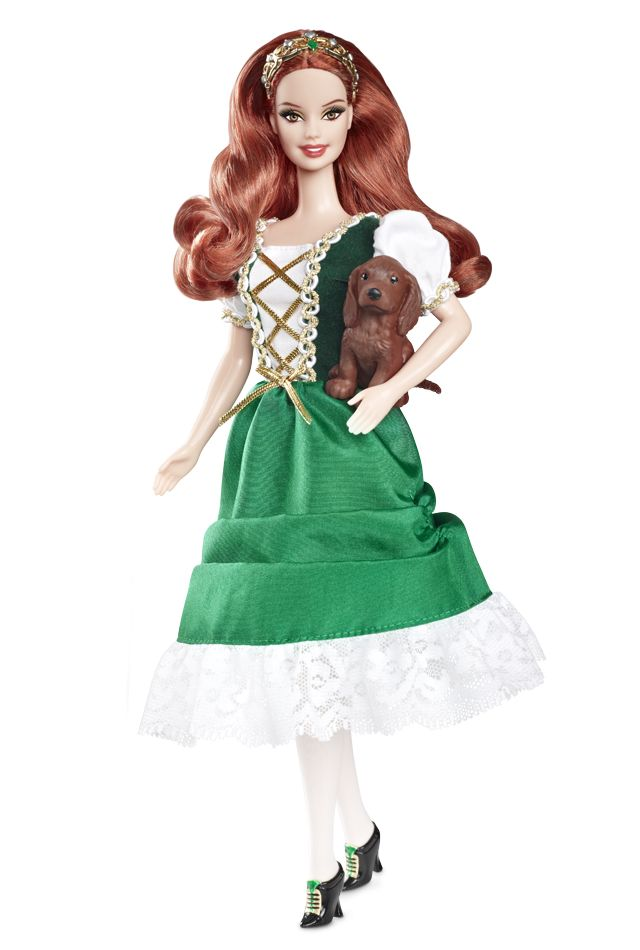 """2011 Ireland Dolls of the world Barbie Doll Pink Label Designed by: Linda Kyaw """"Dia dhuit! That's how I say hello!"""" Barbie® from Ireland displays her heritage in a traditional green dress with laced bodice, short white puffy sleeves and golden trim. Her black shoes with green and golden trim and gorgeous red hair add the perfect touch that make her seem to have all the luck of the Irish! Includes """"passport,"""" country stickers, Irish setter puppy and brush."""