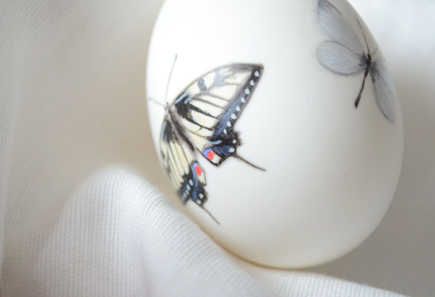 Hand painted butterflies on a duck egg. £8.00, via Etsy.