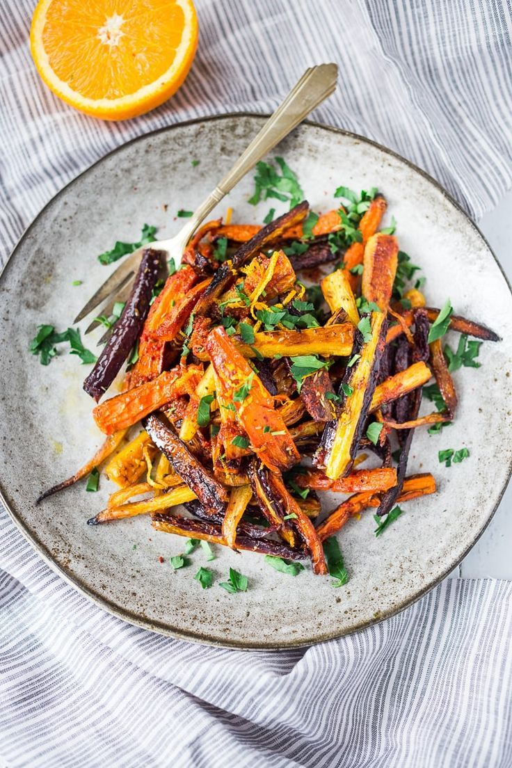 Roasted Moroccan Carrots Sweet and Spicy Roasted Moroccan Carrots- with cumin cinnamon and orange  A Delicious vegan side dish or serve over seasoned lentils for a hearty vegetarian meal    www feastingathom   carrots roastedcarrots