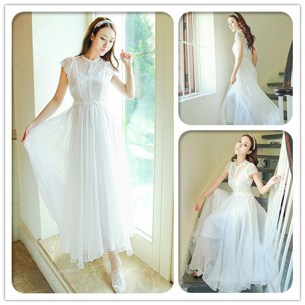 Gorgeous white chiffon tulle wedding dress with lace boning, mesh cap sleeves and a beautiful sheer maxi skirt.