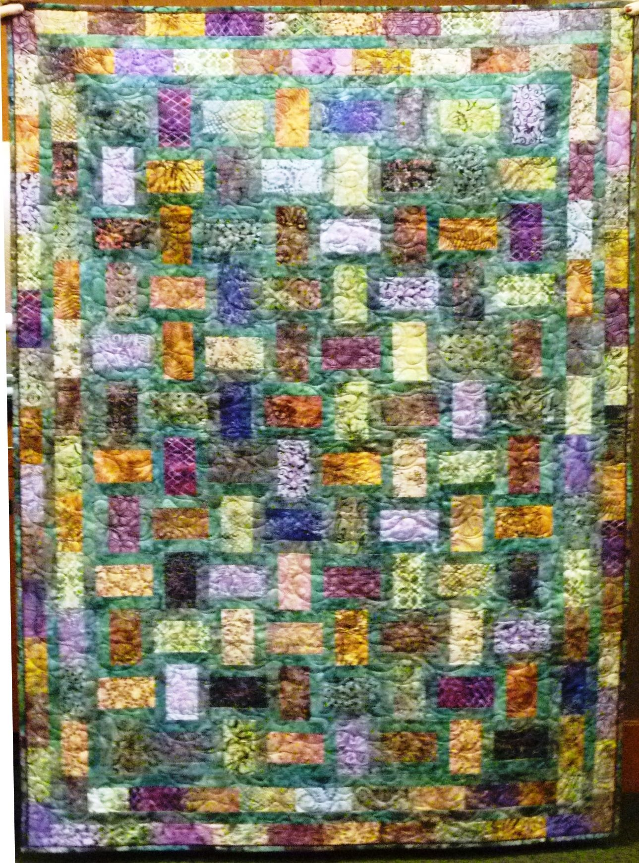 """This quilt is called """"Batik Nickel Bricks"""" and is a lap size that I made for myself. (Feb 2014)"""