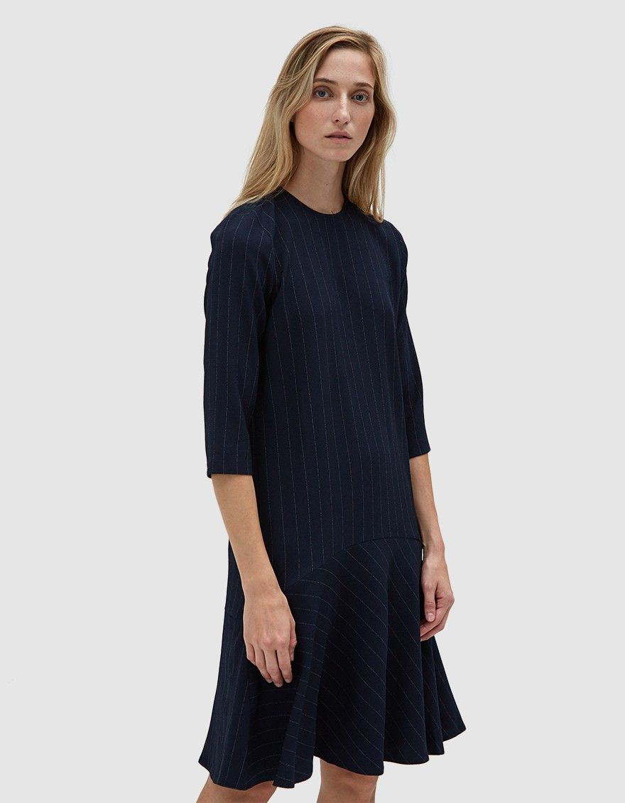 dbe5e182f7d Shift dress from Ganni in Total Eclipse. Subtle pinstripes. Round neckline. Concealed  back zip closure. Three-quarter sleeves. Curved ruffle hem. Unlined.