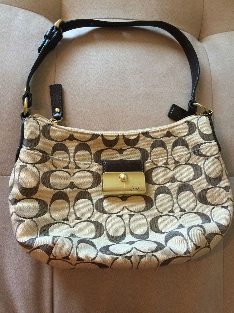 dc0fe19433 Bag · Signature Coach Purse with Light Brown ...