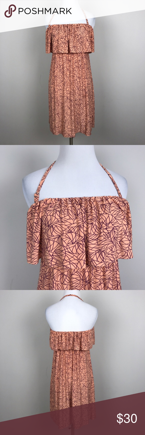 """[Soma] Strapless Halter Tiered Dress Coral Purple Super soft strapless dress. Pullover style with elasticized top and waist. Tiered Ruffle layer. Optional halter strap can be worn as shown. Coral with purple Geometric leaves print.  🔹Pit to Pit: 13""""  🔹Length: 28"""" (from top of bust to hem. 🔹Condition: Excellent pre-owned condition.   *AD21 Soma Dresses Strapless"""