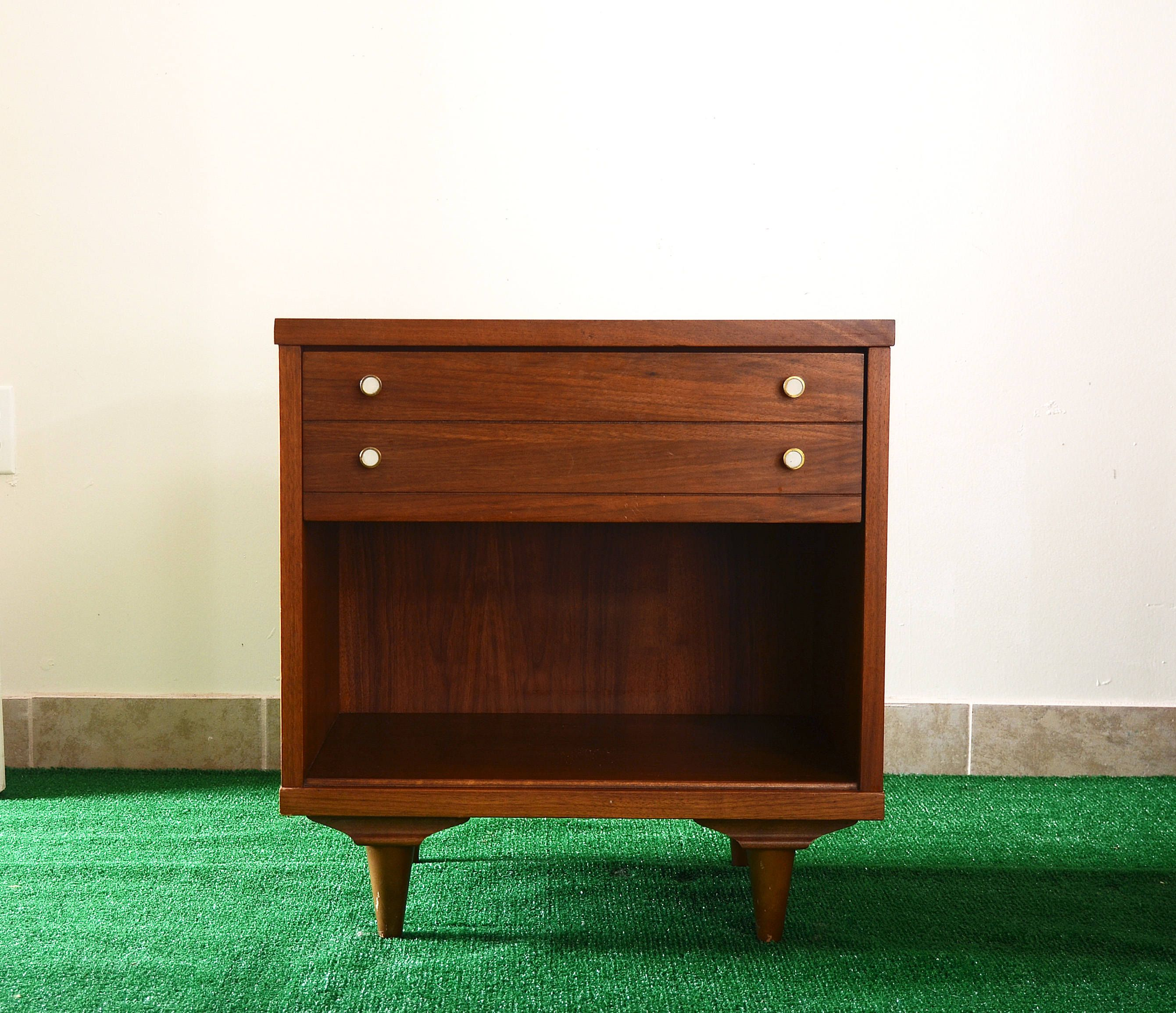MCM walnut night stand with wood grain laminate top in
