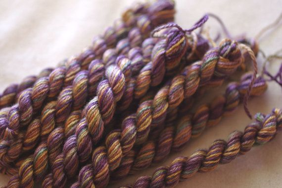 SS 1072-Plum Honey. Plum Honey is a multicolor fiber with rich purples and swirls of yellows. Shepherds Silk is a fiber blend of 50% Wool and 50% Silk Thread hand dyed by us. You are purchasing 1 skein of this thread. Single ply only. Each skein is composed of 20 yards. Please take a moment to look around, there are many colors to choose from.  If you purchase $75 from our shop we will ship your order free (US mailing only).   **Note that colors may vary from what is seen on the monitor due…