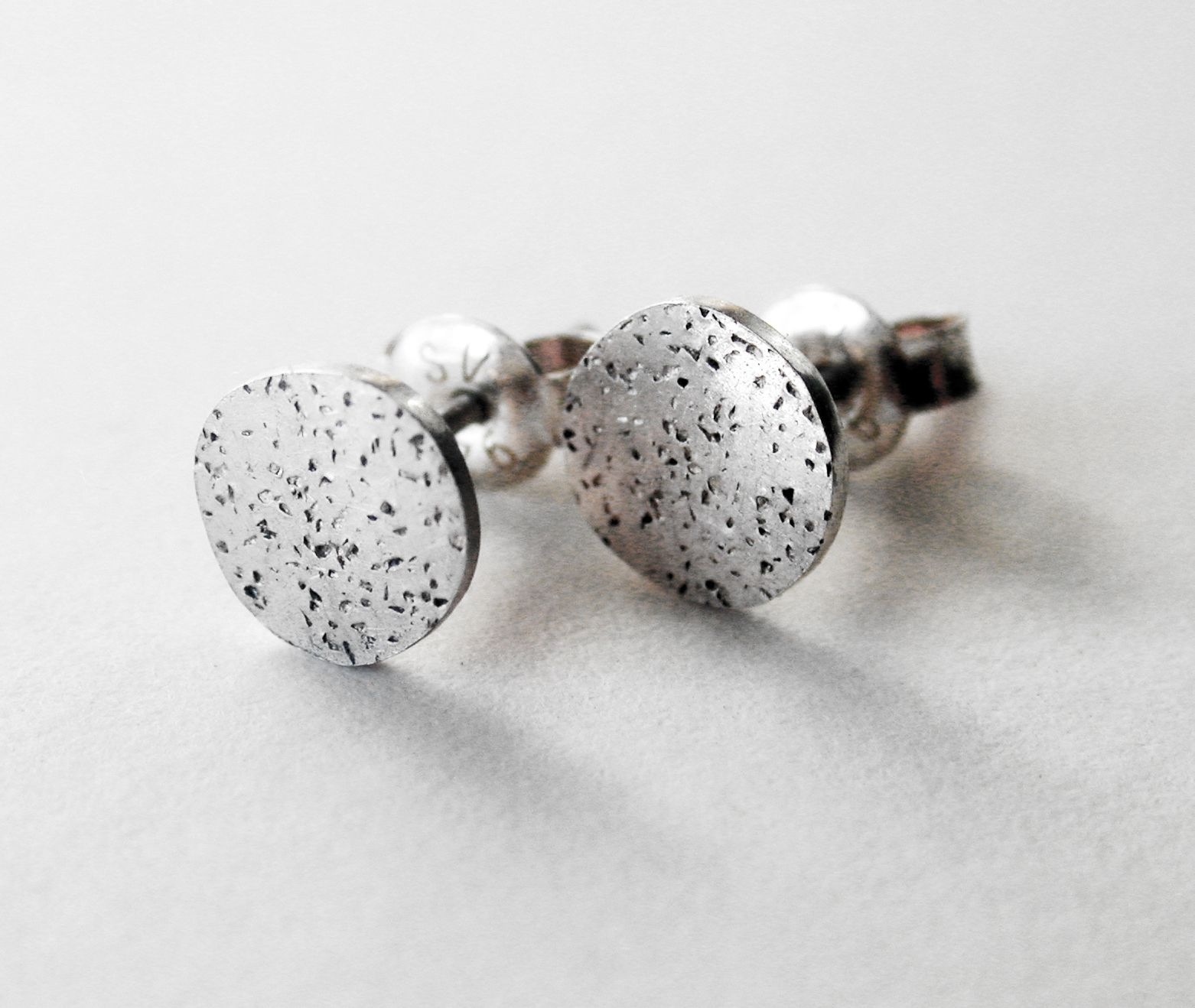 Silver textured stud earrings.  Handmade by Reshma Tia Champaneria jewellery.