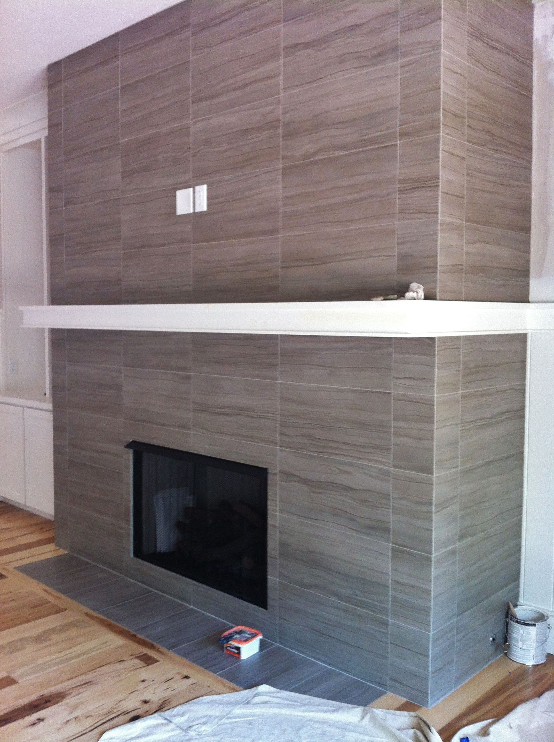 12x24 porcelain tile on fireplace wall